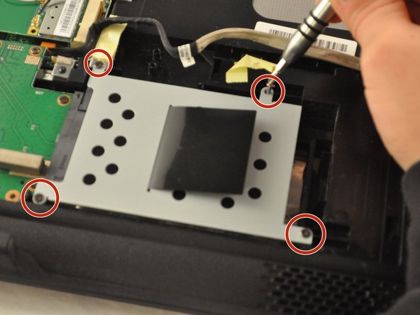 Using the PH1 screwdriver, remove four .75 mm screws from the driver, located in the bottom-right corner of the laptop.
