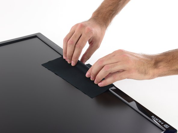 The display bezel is held to the rear case by plastic clips that can be released by pulling straight up on the bezel.
