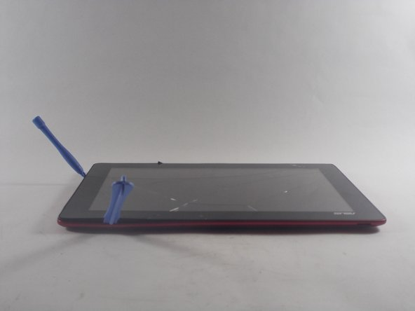 Start by using the plastic opening tool on the side opposite the dock/ charging port. Begin to open the device along the short sides of the tablet.