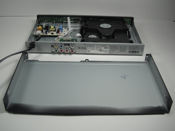 Slide the cover away from the front of the DVD player until it is off.