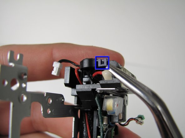 Lift off the tab on top of flash assembly.