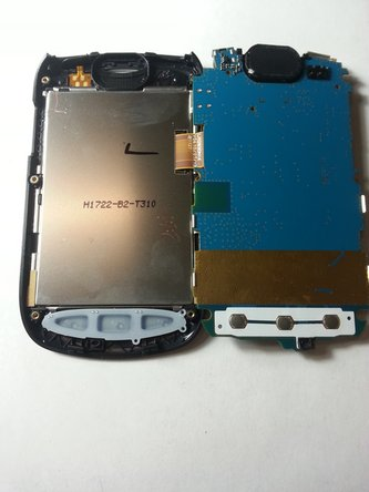 Image 1/2: Starting at the top left corner of the screen (with phone face down),  insert your plastic opening tool and work down the left side.
