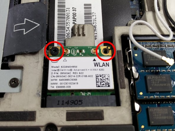 With the two wires removed, remove the two screws holding the Wi-Fi card down.