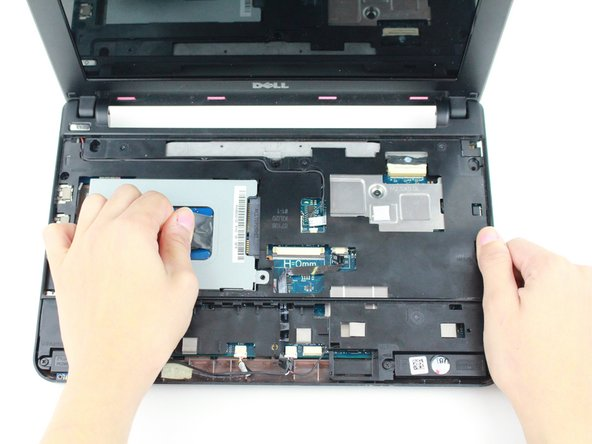 Pull on the black tab and slide the hard-drive cage toward the USB port until is comes free.