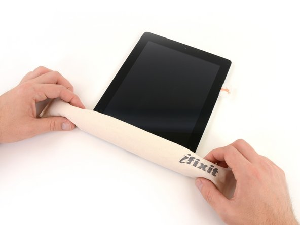 Image 1/1: While you work on releasing the adhesive on the right side of the iPad, reheat the iOpener, and replace it on the bottom edge of the iPad.