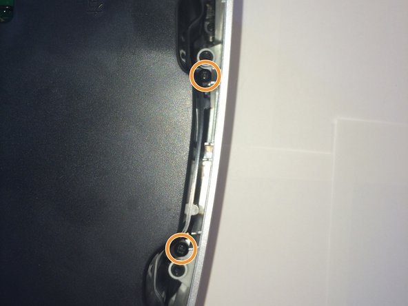 There are 2 more screws for each speaker. The speakers are symmetrical. Remove the 4 screws to free both speakers.