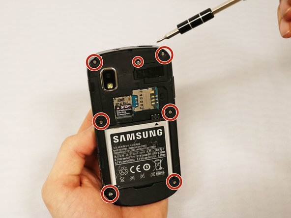 Using the PH000 screwdriver, remove the 7 screws in the back of the device