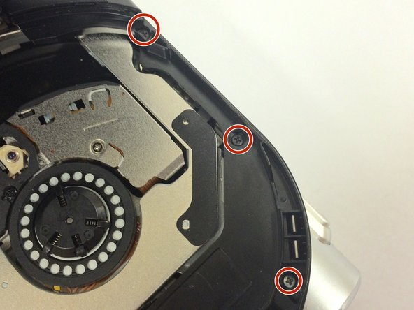 Open the dvd cover and remove the 3 4.3mm phillips screws. Including ones in the corners that may be hidden.