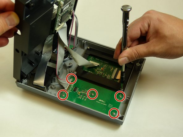 Remove the four 10mm PH #2 screws from the screen assembly, by rotating the screw driver counter clockwise, removing the screw from the housing completely.