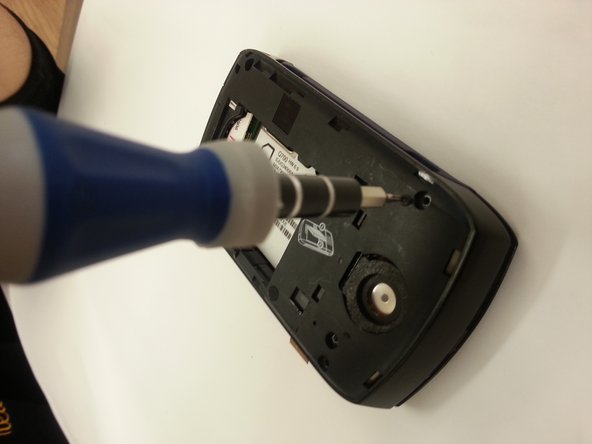 Image 1/1: On the back of the device unscrew the top right, top left, bottom right, and bottom left buttons using appropriate size Phillips screwdriver