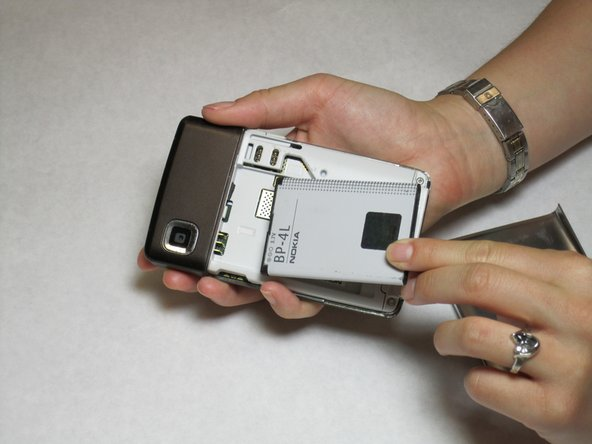 Use your finger to lift the battery out.