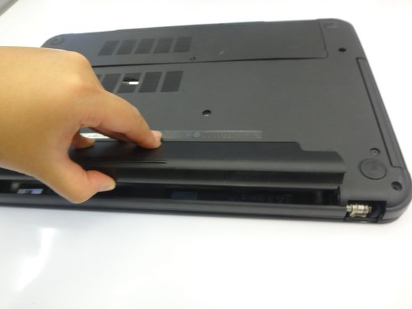 Image 2/3: Slide the latches toward the outside of the laptop to unlock the battery.