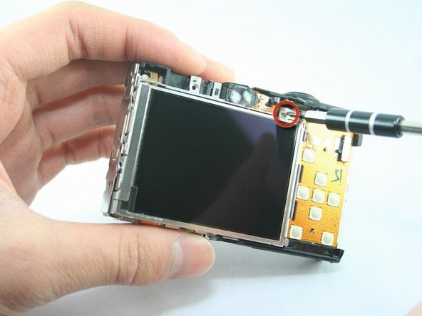 Image 1/2: Remove the L-shaped bar from the right of the LCD screen.