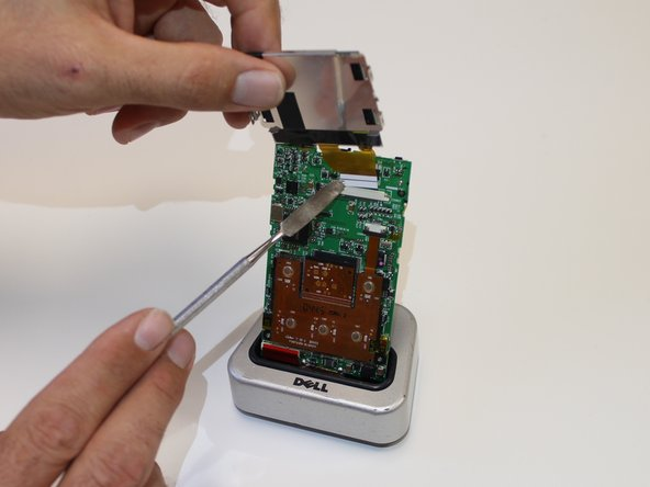 Insert the end of the new screen into the opening of the silver bar, securing it in there to hold your new screen.