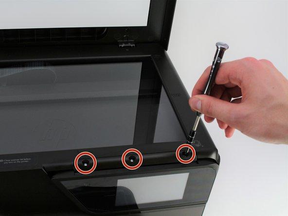 Remove the three 10mm-T10 Torx screws.