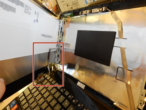 Be careful removing the screen, as the left side is still connected to the computer.