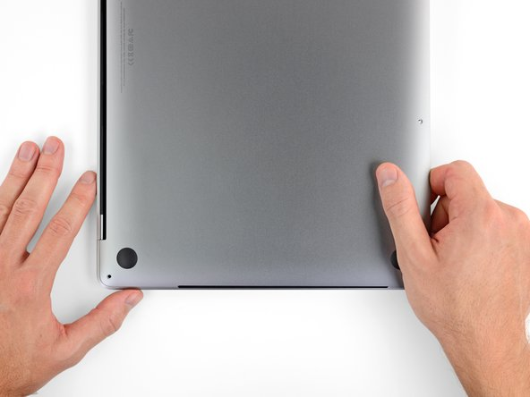 Pull the lower case firmly towards the front of the MacBook (away from the hinge area) to separate the last of the clips securing the lower case.