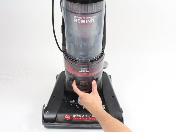 Pull the filter out of the vacuum and replace