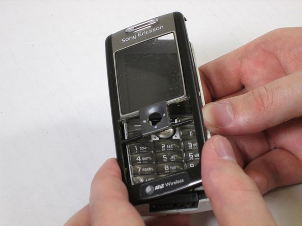 Gently lift and remove the front panel of the phone after removing the screws.
