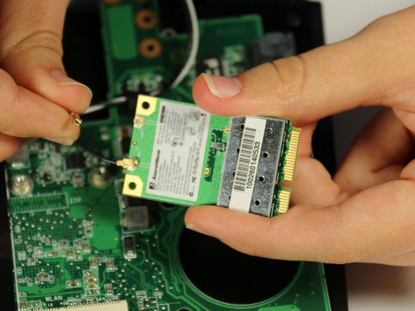 Image 2/3: The wireless network card is now completely detached from the netbook.