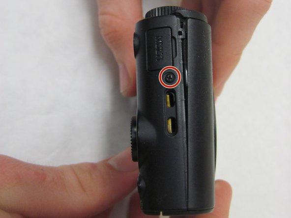 Use the J00 screwdriver to take out the four 4mm black screws on the bottom and both sides of the camera.