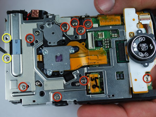 With the case, LCD screen, and release button housing removed, the logic board can be accessed and removed for replacement or repair.