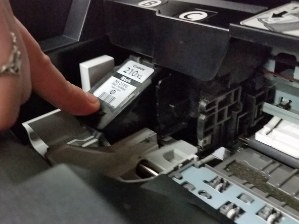 Image 2/3: Push down on the front edge of the ink cartridge.