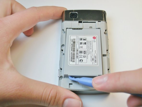 Image 1/1: Pry the battery upward to remove it.