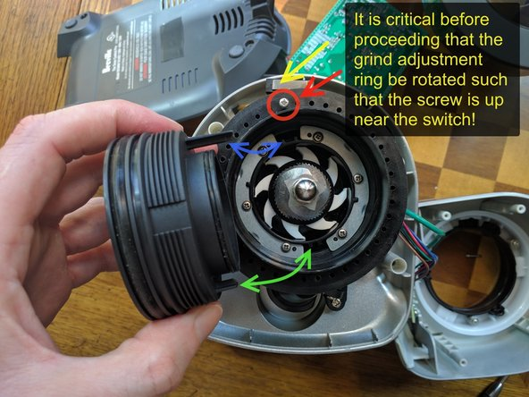 Rotate the grind adjuster until the stop-screw in the first pic is near the switch pointed to by the yellow arrow. This helps the upper-burr-holder threads pickup at the correct spot.