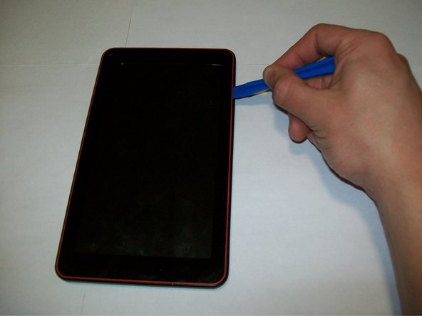 Use the plastic opening tools to pry the screen from the back of the device.
