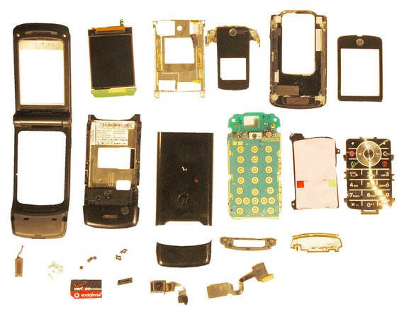 From left to right, top to bottom: Outer Casing, LCD Screen, Upper Metal Frame, Outer LCD cover, Upper Cover, Inner LCD Cover, Lower Metal Casing, Back Casing (Upper), Lower Circuit Board, Keypad, Keypad Membrane, Speaker, Screws, Screw Covers, Back Casing (Lower), Upper Casing Support, Circuit Board Support, SIM Card, USB cover, Camera, Flex Cable