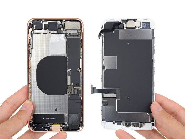 Just a few turns from our Phillips and tri-point drivers and the display is free ... to hit the bench. For the full scoop on the display, check out our iPhone 8 Teardown.