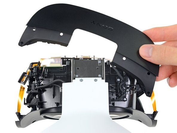 Pulling off the top panel reveals the metal rail that the visor unit slides on when adjusting eye relief.