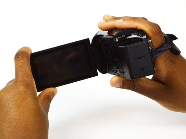 Image 1/1: Position the camera so that the battery is facing you.
