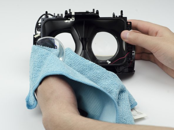 Using a glass cloth (or any cloth with soft fibers), carefully press on the lenses until they pop out of place.