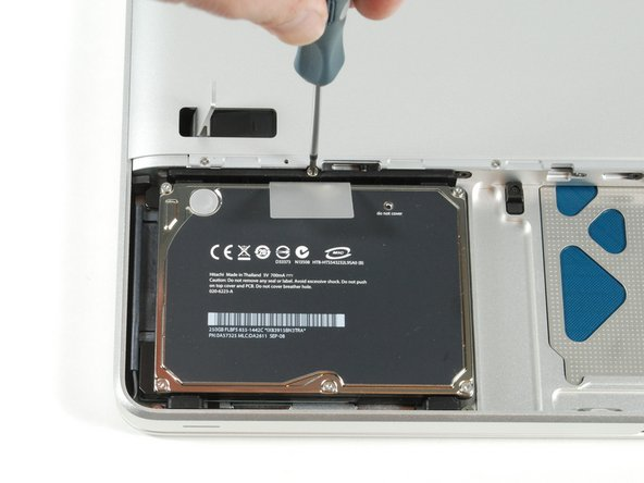 Image 1/1: Remove the four T6 screws securing the hard drive.