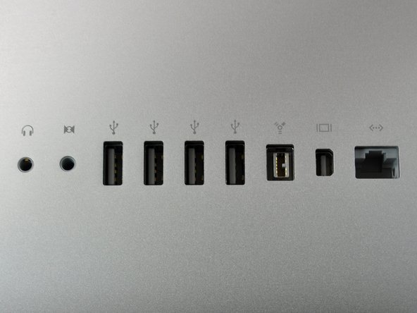 Image 1/1: Nine ports. These are identical to the previous revision, but the Mini DisplayPort has a new trick up its sleeve.