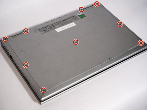 Image 2/2: The cover is held on with small plastic tabs. Starting from the back of the machine use your hands to gently prey the back cover from the machine and release these tabs. While a tool is not necessary a plastic plunger can be used to lift the first few tabs.