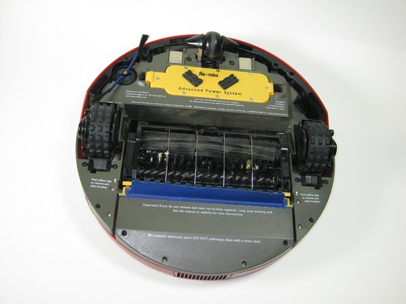 The Roomba Battery is the central yellow block under the Roomba's front bumper. Refer to the top of the graphic.
