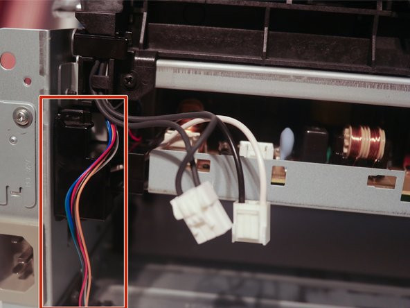 Remove the tray connector cable from the cable guide.