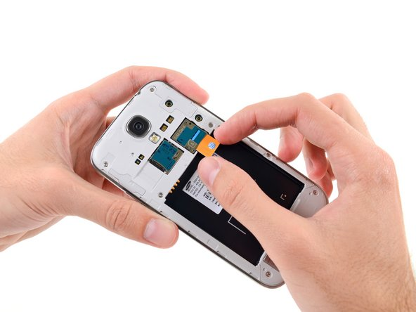 With no time to waste, we slide the pre-installed micro-SIM card out of the way.