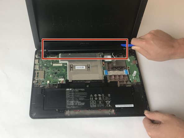 Use plastic opening tool to remove plastic hinge casing located between the screen and keyboard.