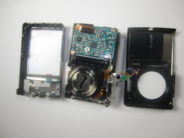 Image 3/3: Remove the front cover entierly from the camera body.