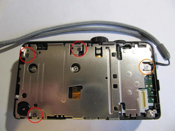 Remove 3 black screws from the mid plate.