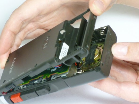 With a firm grip on the larger half, remove the back cover by lifting first on the battery area.