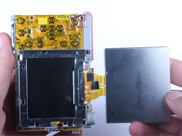 Image 3/3: Do not pull the screen away completely, it is still attached to the logic board via the yellow cable.