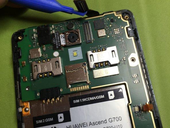 Image 1/2: Sganciare connettore fotocamera