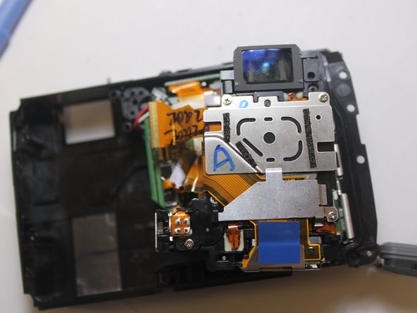 The black component will just fold out for access to the lens mechanism