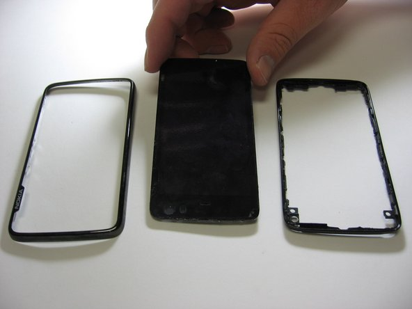Now the screen and one more cover will come right off and you have officially completed  tearing down the nokia n900