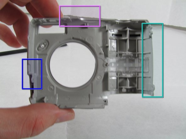 Image 3/3: Right in the middle of the DC-in side (side pictured) of the case.